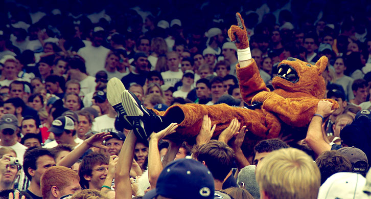 Image of the Nittanly Lion crowdsurfing.