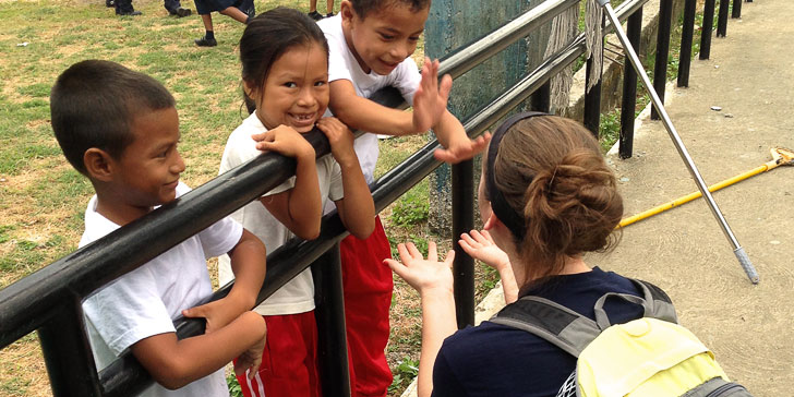 Student working with children in Panama
